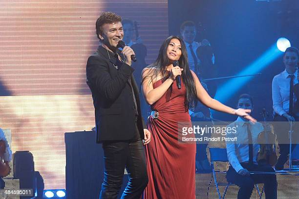 Singer Tony Carreira sings the song 'La neige au Sahara' with singer Anggun whyle his concert at Palais des Sports on April 12 2014 in Paris France