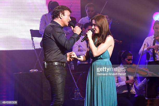 Singer Tony Carreira sings the song 'Sous le vent' with singer Natasha StPier whyle his concert at Palais des Sports on April 12 2014 in Paris France