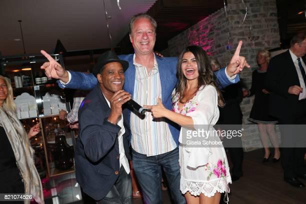 Singer Tony Davis and Tom Gerhardt and his wife Nadja da Silva during the wedding of Torsten Koch and Annika Hofmann at Hotel Wiesergut on July 22...