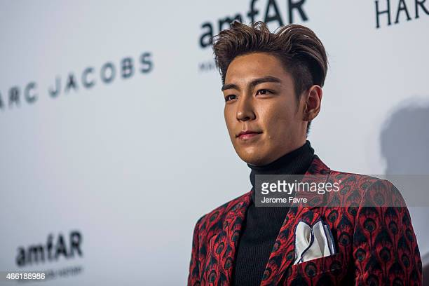 Singer TOP arrives on the red carpet during the 2015 amfAR Hong Kong gala at Shaw Studios on March 14 2015 in Hong Kong