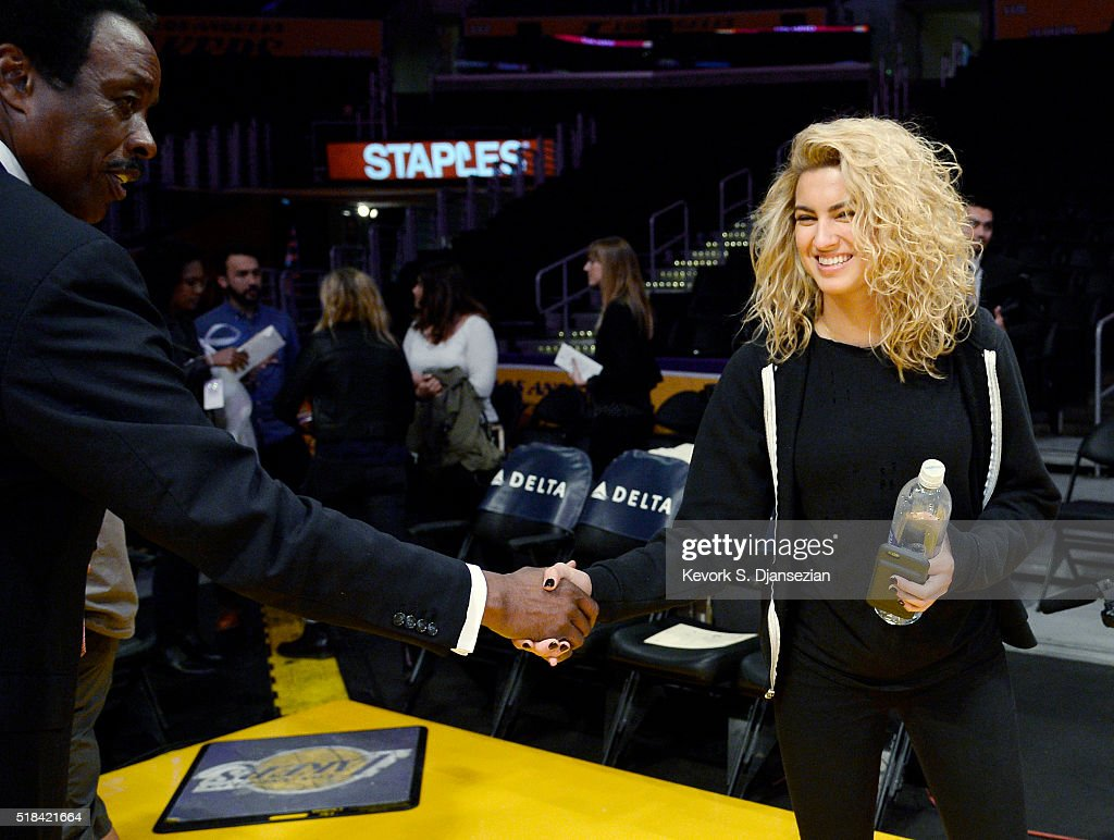 Singer Tori Kelly greets Jim Hill sportscaster at KCBSTV before performing the national anthem at a basketball game between the the Los Angeles...