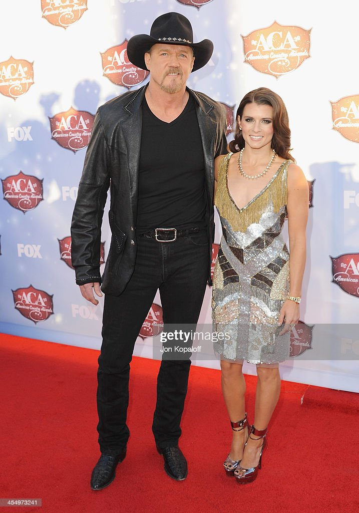 Singer <a gi-track='captionPersonalityLinkClicked' href=/galleries/search?phrase=Trace+Adkins&family=editorial&specificpeople=224686 ng-click='$event.stopPropagation()'>Trace Adkins</a> and NASCAR driver <a gi-track='captionPersonalityLinkClicked' href=/galleries/search?phrase=Danica+Patrick&family=editorial&specificpeople=183352 ng-click='$event.stopPropagation()'>Danica Patrick</a> arrive at the American Country Awards 2013 at the Mandalay Bay Events Center on December 10, 2013 in Las Vegas, Nevada.