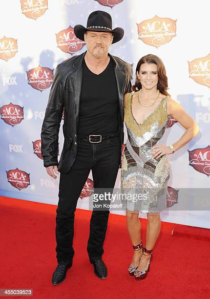 Singer Trace Adkins and NASCAR driver Danica Patrick arrive at the American Country Awards 2013 at the Mandalay Bay Events Center on December 10 2013...