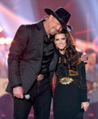 Singer Trace Adkins and NASCAR driver Danica Patrick cohost the American Country Awards 2013 at the Mandalay Bay Events Center on December 10 2013 in...