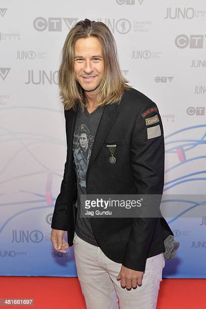 Singer Trevor Guthrie arrives on the red carpet at the 2014 Juno Awards on March 30 2014 in Winnipeg Canada