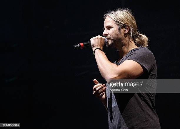 Singer Trevor Guthrie sings on stage during Armin Van Buuren performance at Contact Winter Music Festival at BC Place on December 26 2014 in...