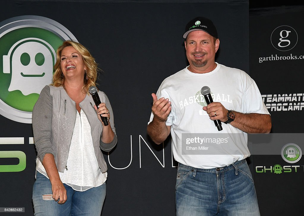 Singer <a gi-track='captionPersonalityLinkClicked' href=/galleries/search?phrase=Trisha+Yearwood&family=editorial&specificpeople=216434 ng-click='$event.stopPropagation()'>Trisha Yearwood</a> (L) and singer/songwriter <a gi-track='captionPersonalityLinkClicked' href=/galleries/search?phrase=Garth+Brooks&family=editorial&specificpeople=206288 ng-click='$event.stopPropagation()'>Garth Brooks</a> speak during a news conference ahead of the first of their scheduled six shows at T-Mobile Arena on June 24, 2016 in Las Vegas, Nevada.