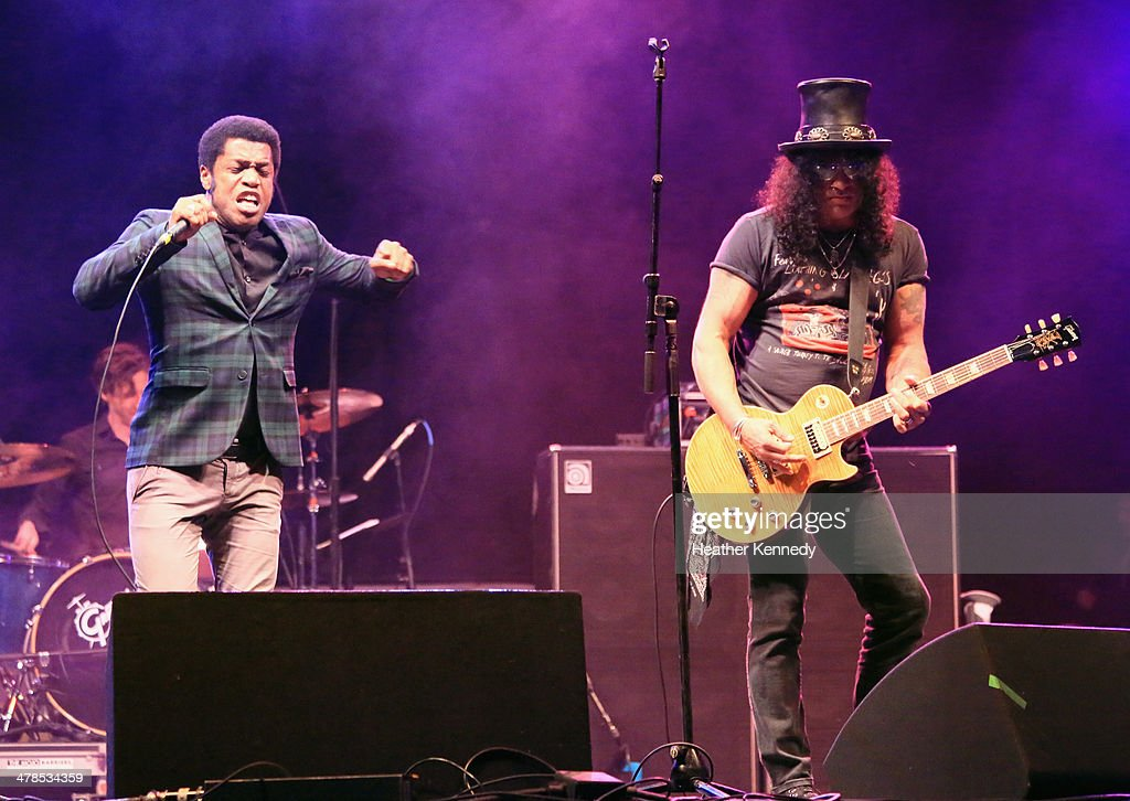 Singer Ty Taylor of Vintage Trouble and musician Slash perform onstage during the USPS Hendrix Stamp Event + Los Lonely Boys during the 2014 SXSW Music, Film + Interactive at Butler Park on March 13, 2014 in Austin, Texas.