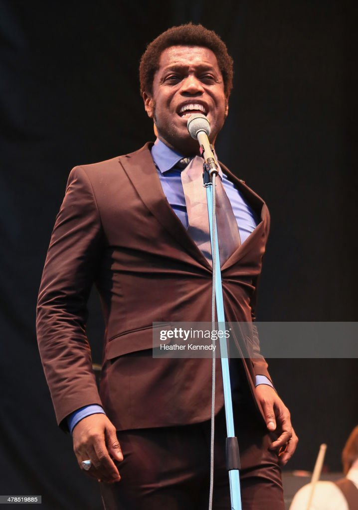 Singer <a gi-track='captionPersonalityLinkClicked' href=/galleries/search?phrase=Ty+Taylor&family=editorial&specificpeople=2209533 ng-click='$event.stopPropagation()'>Ty Taylor</a> of Vintage Trouble performs onstage at the USPS Hendrix Stamp Event + Los Lonely Boys during the 2014 SXSW Music, Film + Interactive at Butler Park on March 13, 2014 in Austin, Texas.
