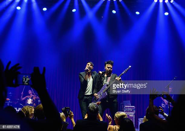Singer Tyler Glenn and bassist Branden Campbell of Neon Trees perform during the Scleroderma Research Foundations' Cool Comedy Hot Cuisine fundraiser...