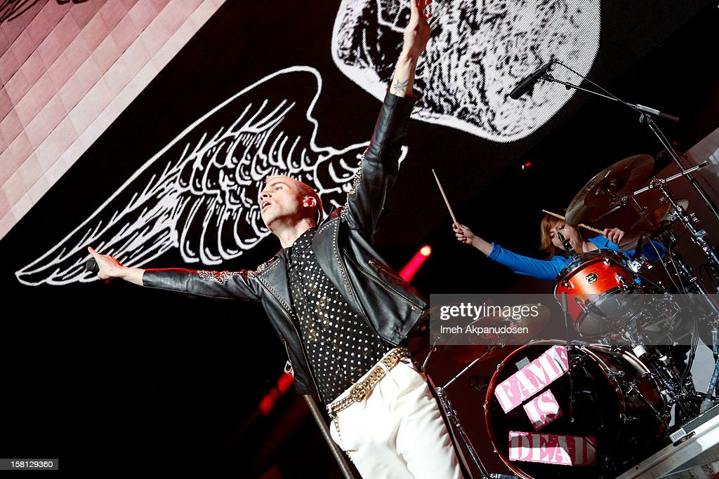Singer Tyler Glenn (L) and drummer Elaine Bradley of Neon Tyler perform onstage at the 23rd Annual KROQ Almost Acoustic Christmas at Gibson Amphitheatre on December 9, 2012 in Universal City, California.