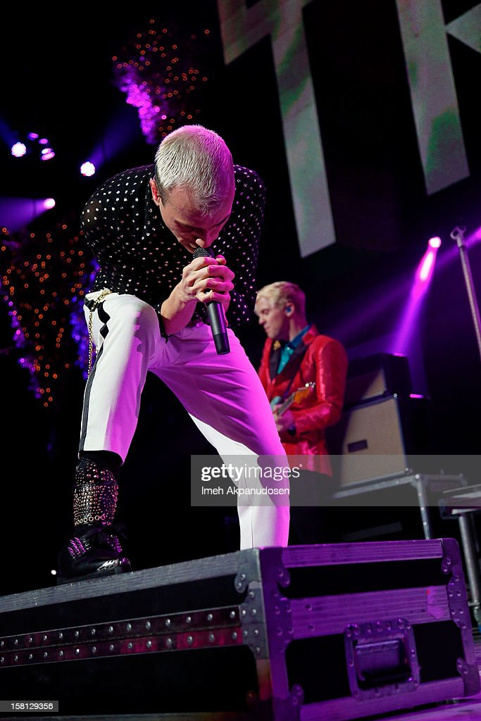 Singer Tyler Glenn (L) and guitarist Chris Allen of Neon Tyler perform onstage at the 23rd Annual KROQ Almost Acoustic Christmas at Gibson Amphitheatre on December 9, 2012 in Universal City, California.