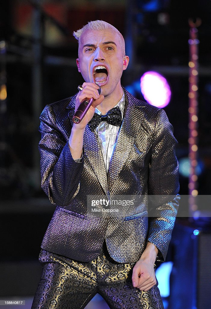 Singer Tyler Glenn of the band Neon Trees peforms during New Year's Eve 2013 In Times Square at Times Square on December 31, 2012 in New York City.