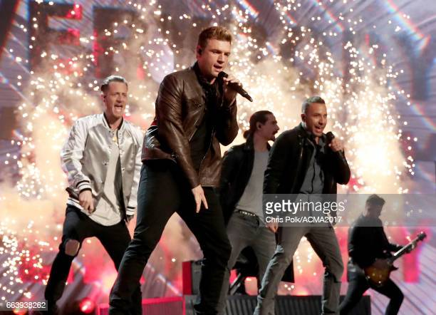 Singer Tyler Hubbard of Florida Georgia Line performs onstage with singers Nick Carter Kevin Richardson and Howie D of the Backstreet Boys during the...