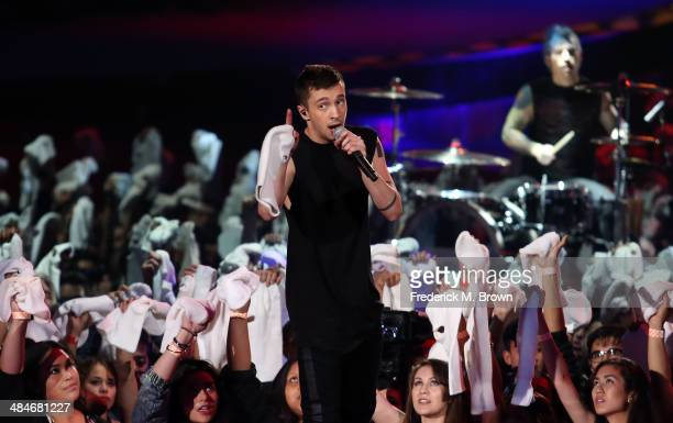 Singer Tyler Joseph of Twenty One Pilots performs onstage at the 2014 MTV Movie Awards at Nokia Theatre LA Live on April 13 2014 in Los Angeles...