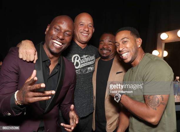 Singer Tyrese Gibson actor Vin Diesel director F Gary Gray and rapper Ludacris at CinemaCon 2017 Universal Pictures Invites You to a Special...