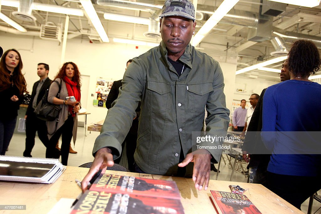 Singer Tyrese Gibson attends the Taco Bell Foundation for teens and get schooled graduate for Mas Program 1 year anniversary held at the Locke College Preparatory Academy on March 6, 2014 in Los Angeles, California.