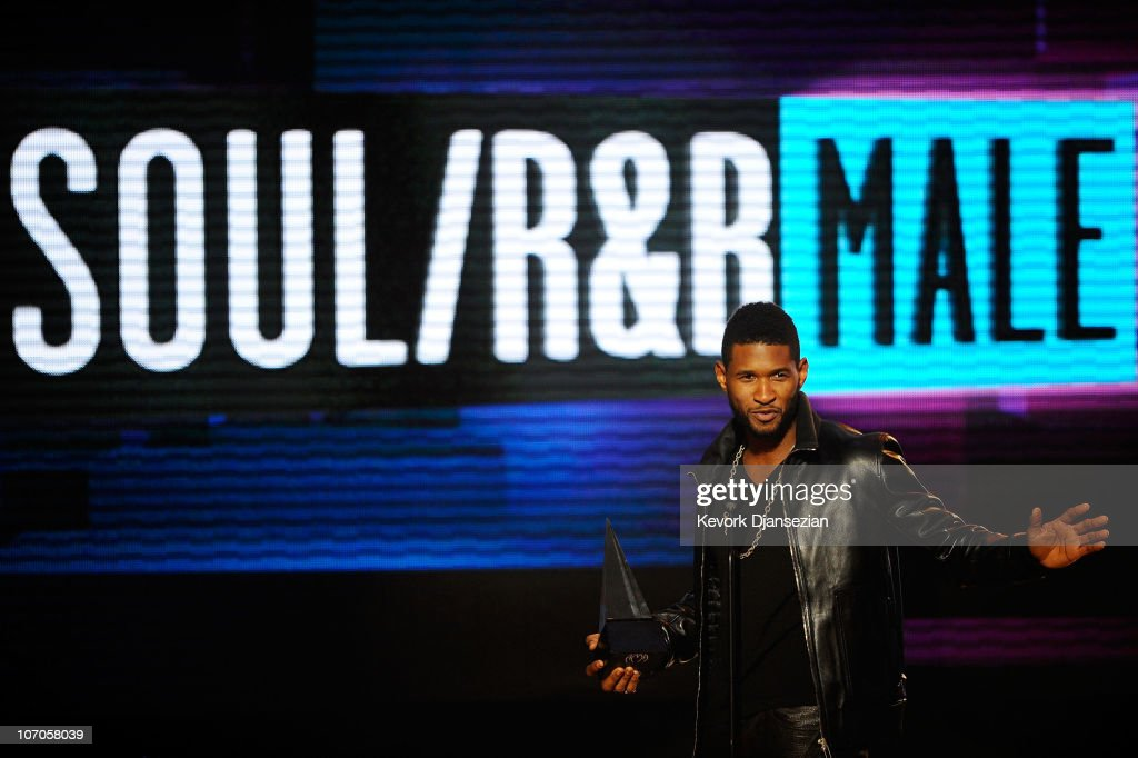 Singer Usher accepts the Soul/Rhythm & Blues Music - Favorite Male Artist award onstage during the 2010 American Music Awards held at Nokia Theatre L.A. Live on November 21, 2010 in Los Angeles, California.