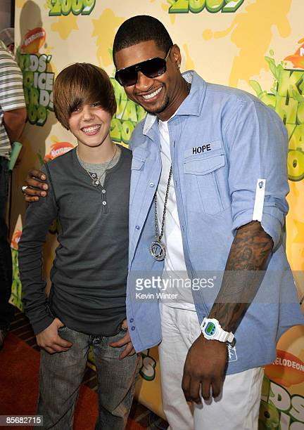 Singer Usher and Justin Bieber arrive at Nickelodeon's 2009 Kids' Choice Awards at UCLA's Pauley Pavilion on March 28 2009 in Westwood California