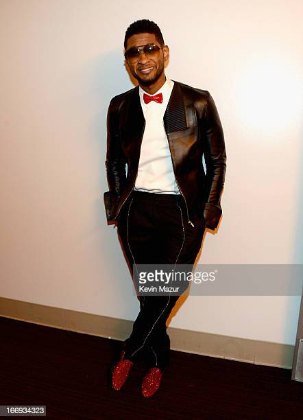 Singer Usher attends the 28th Annual Rock and Roll Hall of Fame Induction Ceremony at Nokia Theatre LA Live on April 18 2013 in Los Angeles California