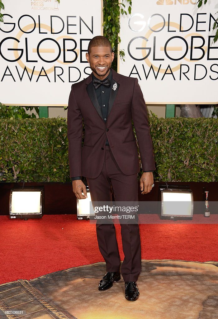 Singer Usher attends the 71st Annual Golden Globe Awards held at The Beverly Hilton Hotel on January 12 2014 in Beverly Hills California
