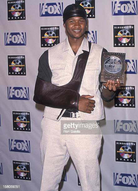 Singer Usher attends the Fifth Annual Blockbuster Entertainment Awards on May 25 1999 at the Shrine Auditorium in Los Angeles California