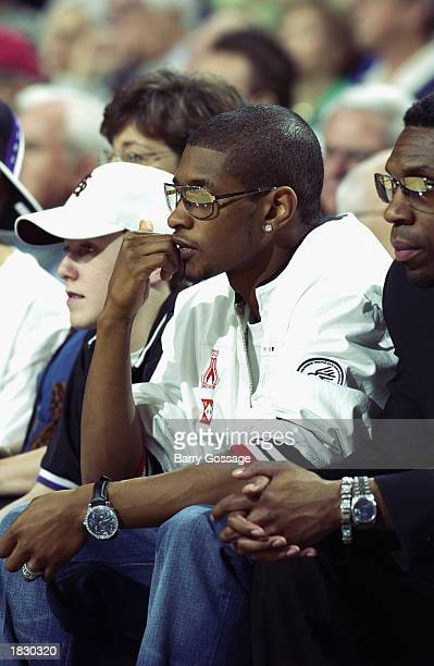 Singer Usher attends the game between the Boston Celtics and the Phoenix Suns during the game at America West Arena on February 16 2003 in Phoenix...