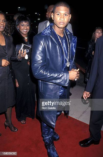 Singer Usher attends the 'Light It Up' Hollywood Premiere on November 4 1999 at the Pacific's Cinerama Dome in Hollywood California