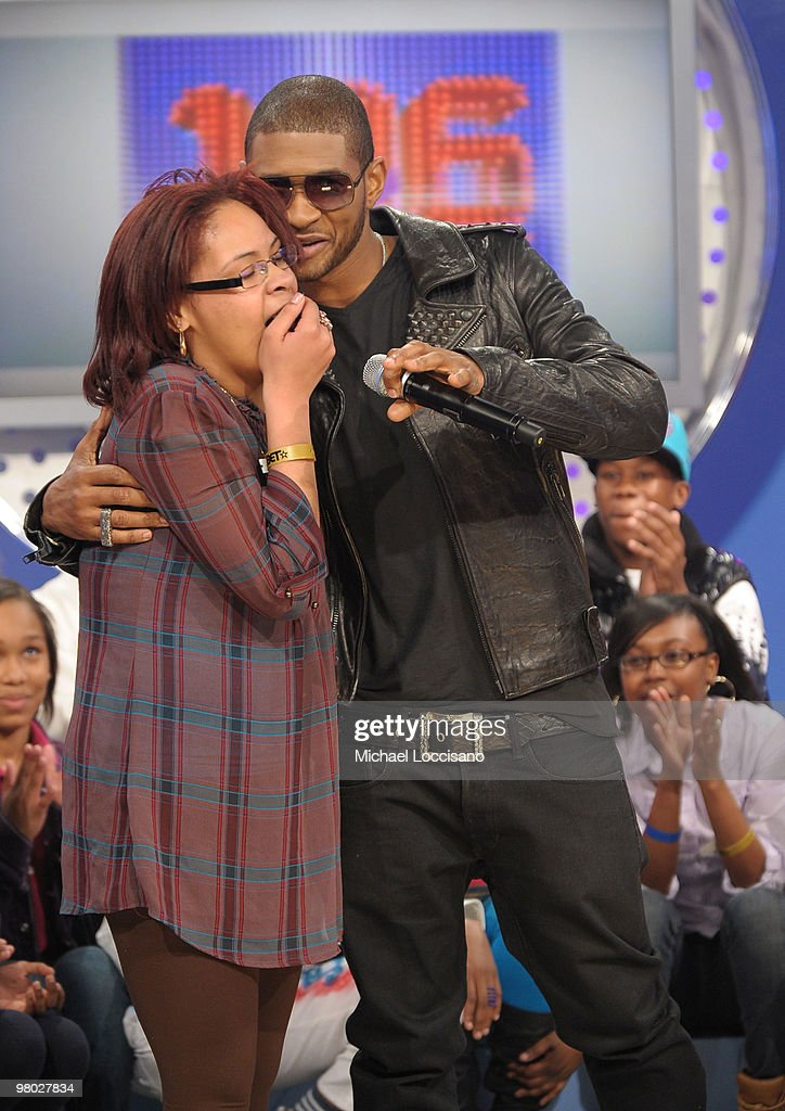 Singer Usher embraces a fan on BET's '106 & Park' at BET Studios on March 24, 2010 in New York City.