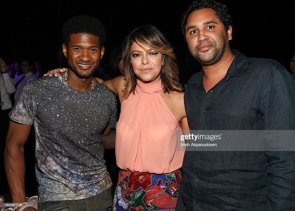 Singer Usher, founder of The Pink Party, <a gi-track='captionPersonalityLinkClicked' href=/galleries/search?phrase=Elyse+Walker&family=editorial&specificpeople=4361259 ng-click='$event.stopPropagation()'>Elyse Walker</a>, and artist RETNA attend FIJI Water at the 9th Annual Pink Party Benefiting The Cedars-Sinai Women's Cancer Program at
