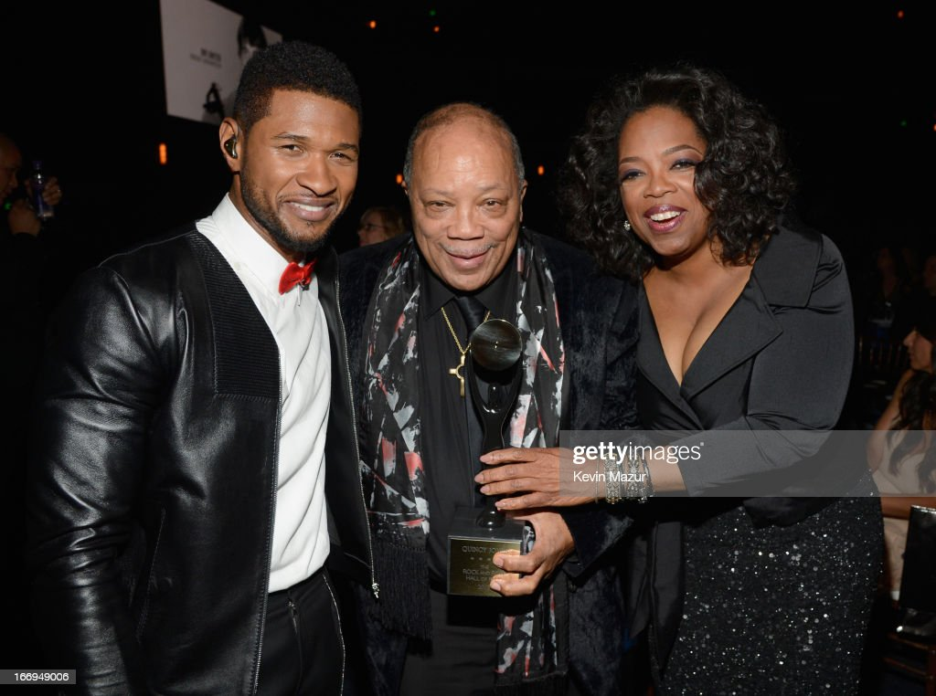 Singer Usher, inductee <a gi-track='captionPersonalityLinkClicked' href=/galleries/search?phrase=Quincy+Jones&family=editorial&specificpeople=171797 ng-click='$event.stopPropagation()'>Quincy Jones</a> and <a gi-track='captionPersonalityLinkClicked' href=/galleries/search?phrase=Oprah+Winfrey&family=editorial&specificpeople=171750 ng-click='$event.stopPropagation()'>Oprah Winfrey</a> attend the 28th Annual Rock and Roll Hall of Fame Induction Ceremony at Nokia Theatre L.A. Live on April 18, 2013 in Los Angeles, California.