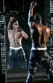 Singer Usher performs at the 2004 MTV Video Music Awards at the American Airlines Arena August 29 2004 in Miami Florida