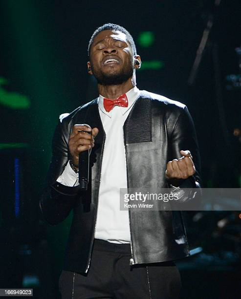 Singer Usher performs on stage at the 28th Annual Rock and Roll Hall of Fame Induction Ceremony at Nokia Theatre LA Live on April 18 2013 in Los...