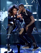 Singer Usher performs onstage during the BET AWARDS '14 at Nokia Theatre LA LIVE on June 29 2014 in Los Angeles California