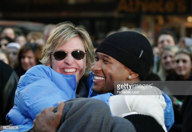 Singer Usher picks up host Ellen DeGeneres during a taping of 'The Ellen DeGeneres Show' in Times Square November 19 2005 in New York City