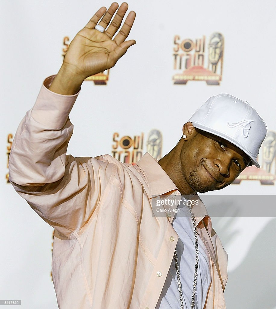 Singer <a gi-track='captionPersonalityLinkClicked' href=/galleries/search?phrase=Usher+-+Singer&family=editorial&specificpeople=201477 ng-click='$event.stopPropagation()'>Usher</a> poses in the press room at the 18th Annual Soul Train Music Awards March 20, 2004 in Los Angeles, California. The Awards were broadcast live in first run, national syndication.