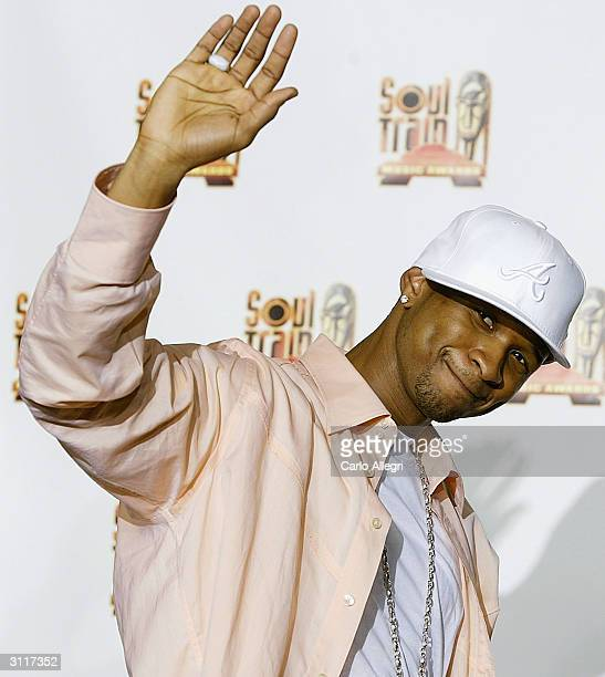 Singer Usher poses in the press room at the 18th Annual Soul Train Music Awards March 20 2004 in Los Angeles California The Awards were broadcast...