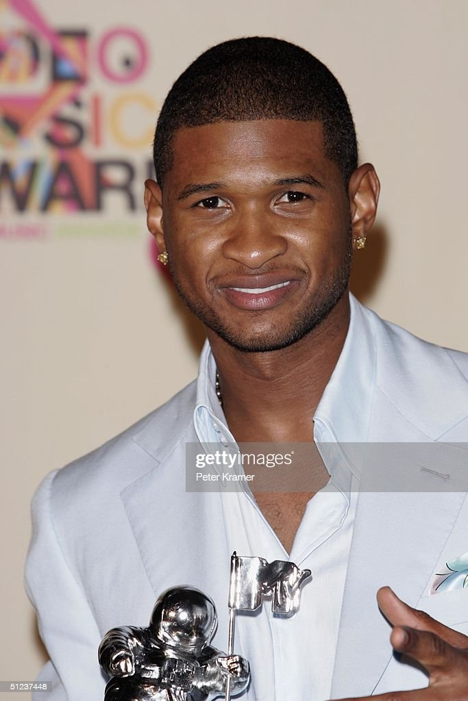 Singer <a gi-track='captionPersonalityLinkClicked' href=/galleries/search?phrase=Usher+-+Singer&family=editorial&specificpeople=201477 ng-click='$event.stopPropagation()'>Usher</a> poses with his awards for Best Male and Best Dance in the press room at the 2004 MTV Video Music Awards on August 29, 2004 at the American Airlines Arena, in Miami, Florida.