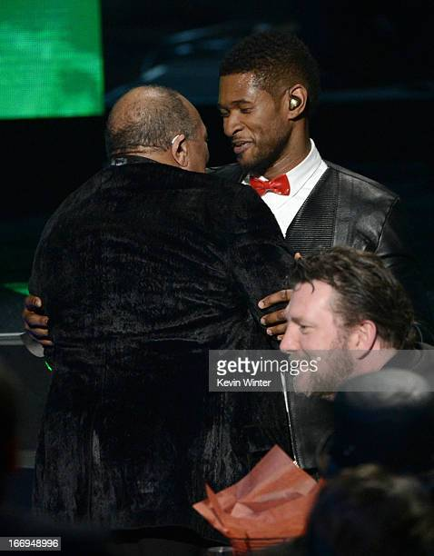 Singer Usher presents inductee Quincy Jones the Ahmet Ertegun Award for Lifetime Achievement on stage at the 28th Annual Rock and Roll Hall of Fame...