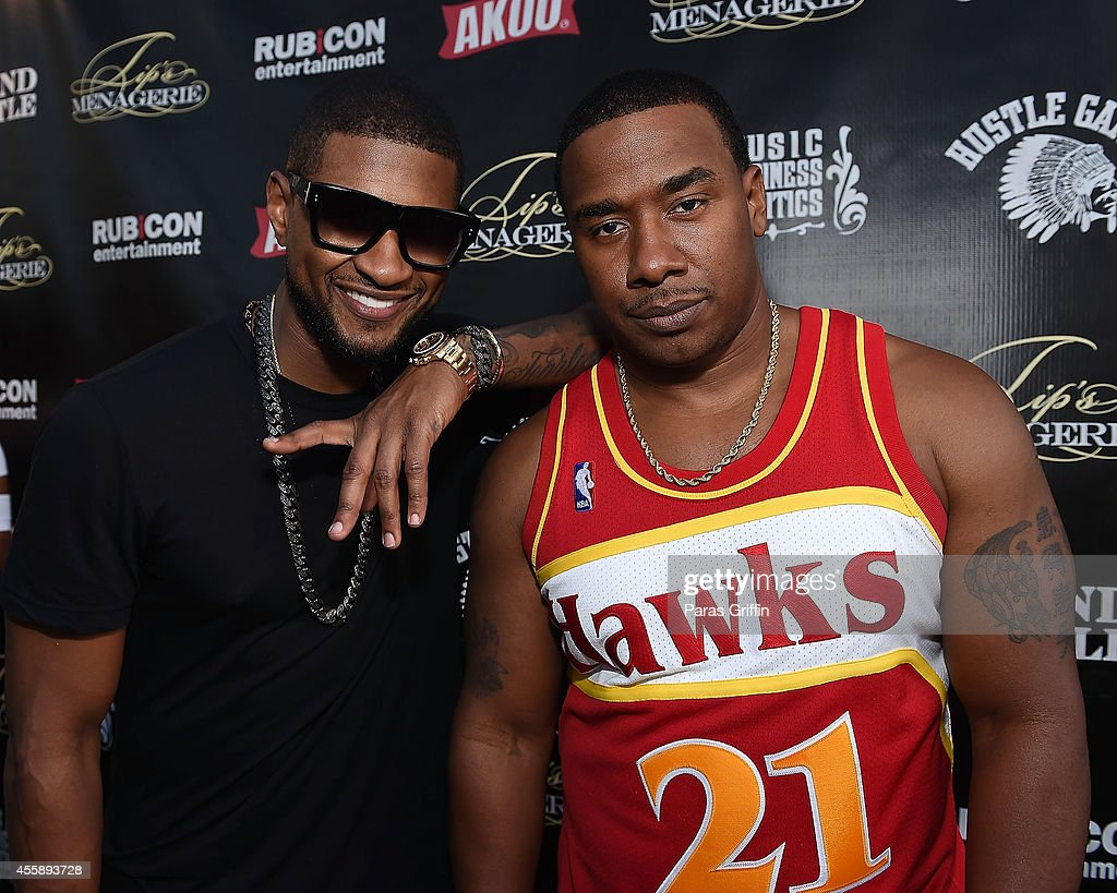 Singer Usher Raymond and Kawan 'KP' Prather attend 'Festa De Rei Feast of Kings' at Little Italia on September 21 2014 in Atlanta Georgia