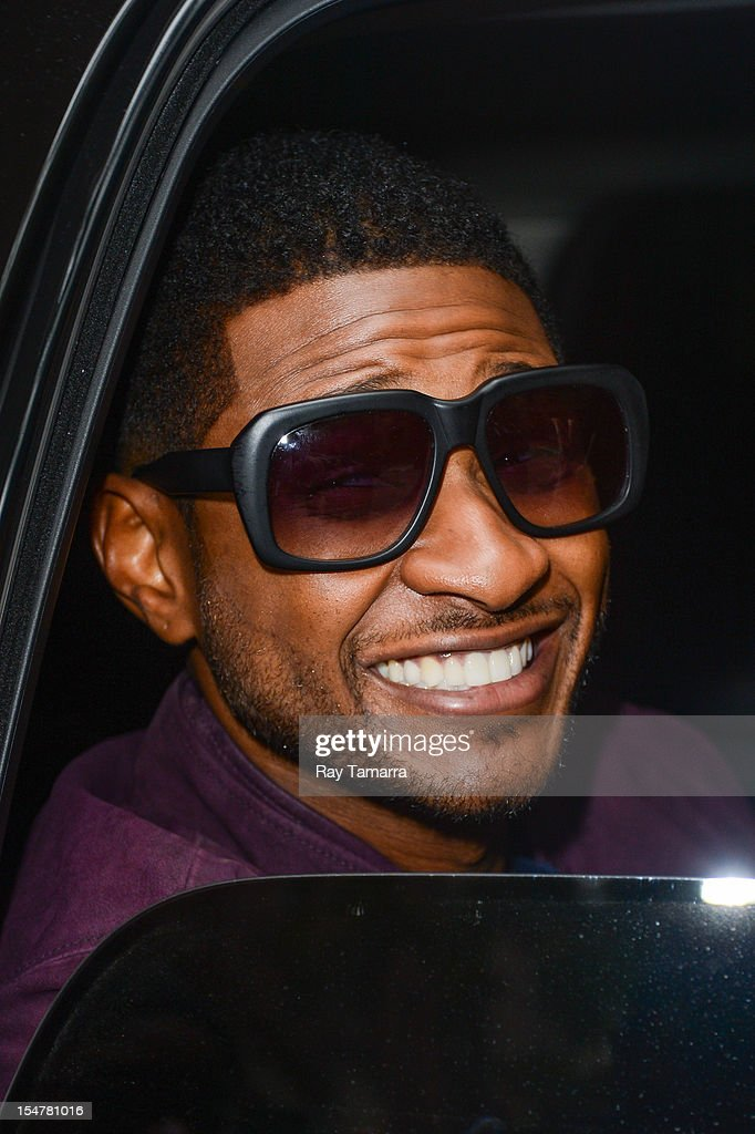 Singer Usher Raymond IV leaves the 'Live With Kelly And Michael' taping at the ABC Lincoln Center Studios on October 25, 2012 in New York City.