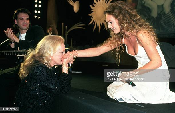 Singer Vanessa Paradis and actress Jeanne Moreau during Cannes Film Festival in Cannes France in May 1995 Vanessa Paradis sang 'Le Tourbillon' a song...