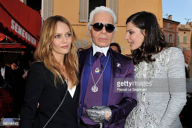 Singer Vanessa Paradis Karl Lagerfeld and actress Anna Mouglalis pose during the Chanel Cruise Collection Presentation on May 11 2010 in SaintTropez...