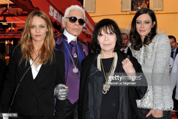 Singer Vanessa Paradis Karl Lagerfeld singer Juliette Greco and actress Anna Mouglalis pose during the Chanel Cruise Collection Presentation on May...