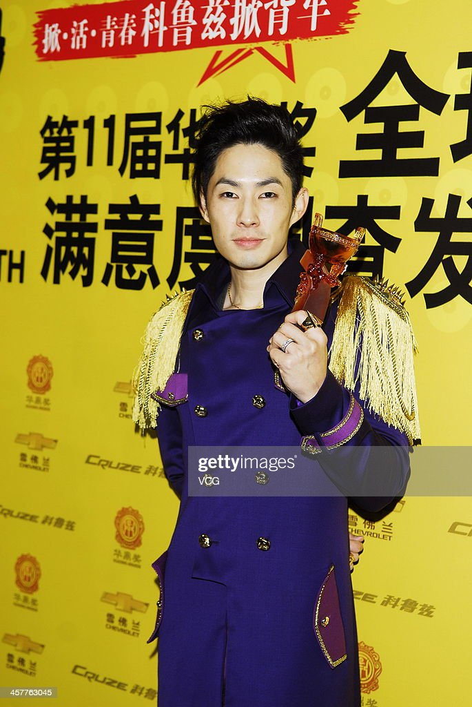 Singer <a gi-track='captionPersonalityLinkClicked' href=/galleries/search?phrase=Vanness+Wu&family=editorial&specificpeople=644546 ng-click='$event.stopPropagation()'>Vanness Wu</a> attends the 11th Huading Global Music Satisfaction Survey Release Ceremony at Shanghai Expo Centre on December 18, 2013 in Shanghai, China.