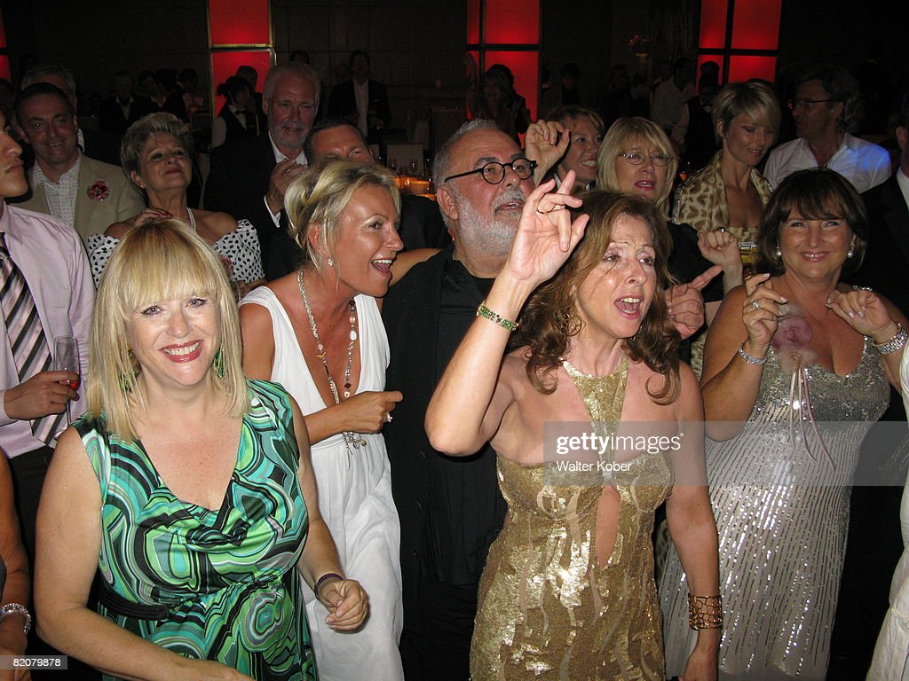 Singer Vicky Leandros (2nd R) and Udo Walz (C) celebrate during the wedding celebrations of Udo Walz and his partner Carsten Thamm at the China Club on July 26, 2008 in Berlin, Germany .