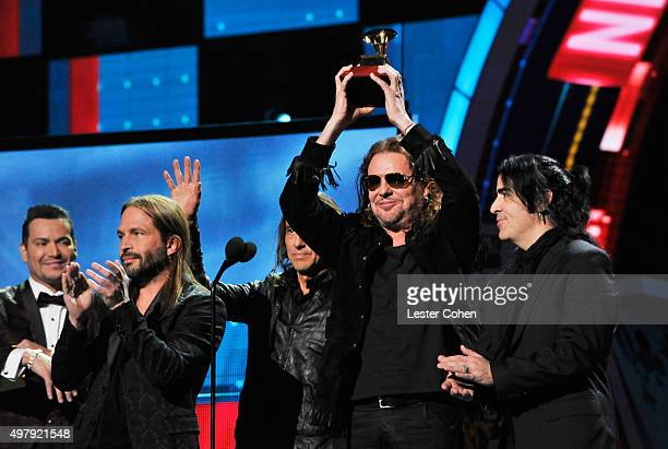 Singer Victor Manuelle presents musicians Sergio Vallin Juan Calleros Fher Olvera and Alex Gonzalez of Mana with the Best Pop/Rock Album Award for...