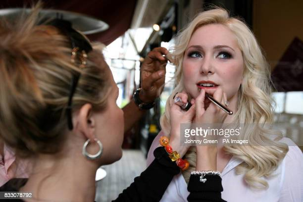 Singer Victoria Hart has final adjustments made to her hair and makeup outside the Naked Turtle restaurant in Richmond in southwest London