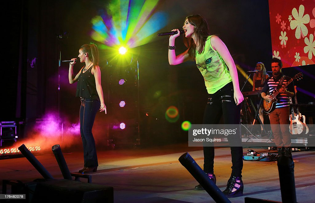 Singer Victoria Justice (R) and her sister Madison Reed perform at the Iowa State Fair on August 13, 2013 in Des Moines, Iowa.