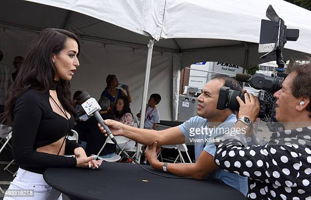 Singer Victoria Ortiz 'La Mala' takes an interview at Latin GRAMMY Street Parties Los Angeles at Placita Olvera on October 18 2015 in Los Angeles...